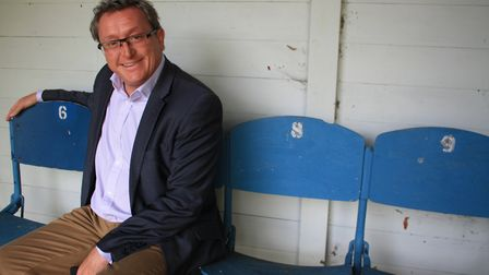 Mark Godfrey sits on the Wembley Bench at the Deer Park Country House.