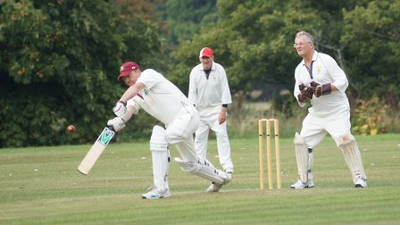 Richard Coombs batting for Newton Poppleford and Chris Tubbs keeping wicket for Tipton St John. Pict