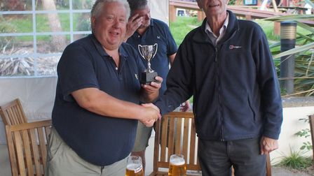 Newton Poppleford's Kenny Clay receives the trophy from Tipton's David O'Higgins Picture PHIL WRIGHT