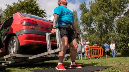 Ottery man Paul Harradence competing in the car deadlift class in the Strongman contest. Picture: Ch