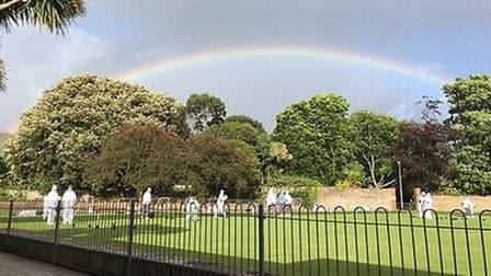 A rainbow over Sidmouth bowlers