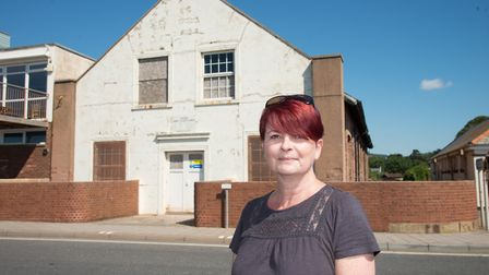 Gillian Mitchell pictured by the derelict drill hall on the Esplande at Port Royal. Picture: Alex Wa