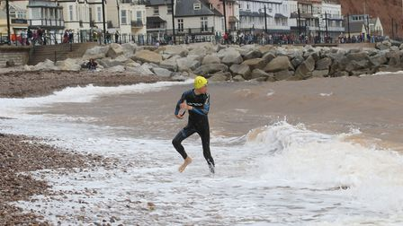 George Manley coming ashore first in the 1km race. Picture SIMON HORN