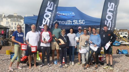 Joe Pavey MBE with the winners from The Great Sea Swim off Sidmouth. Picture SIMON HORN