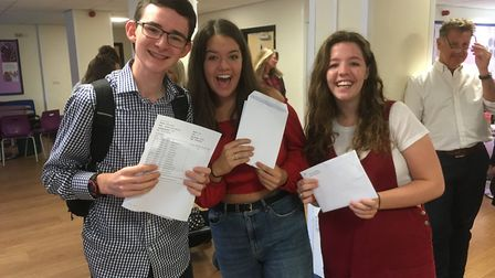 Michael Penston with Emily and Georgia Bramley get their results at The King's School, Ottery St Mar