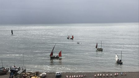 The luggers on calm seas at Beer Regatta. Picture: Fiona Gage