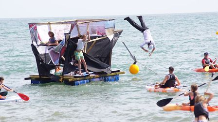 Man overboard the deocrated Napoli raft at Beer Regatta. Picture: Fiona Gage