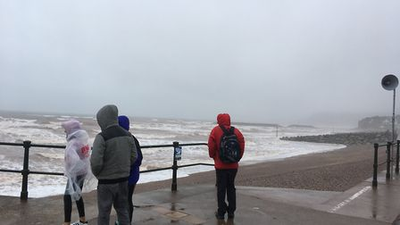 Cagoules are order of the day on Sidmouth seafront