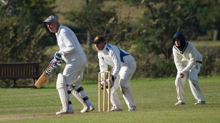 Tipton batsman Phil Tolley on his way to his 100th half century for the club. Also in the pitcure ar