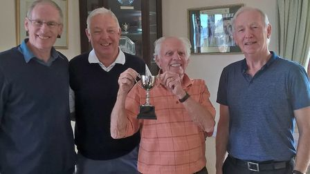 Sidmouth seniors captain Tony Stoyle presenting the Autumn Cup to Ray Gunston, Charles Warren and Ph