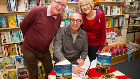 David 'Bumble' Lloyd signing a book for Andy and Barbara Ingman at Paragon Books in Sidmouth. Ref sh