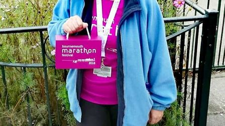 Sidmouth Running Club member Abbi Lee looking (quite rightly) very happy after completing the Bourne