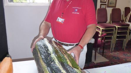 Air Ambulance volunteer Simon Card with a giant marrow grown for the event. Picture: Devon Air Ambul