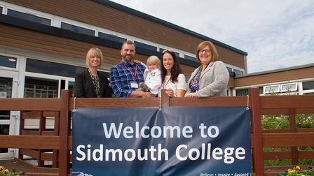 Rebecca and Mark Burdus and their daughter Billie at Sidmouth College with Principal Sarah Parsons a