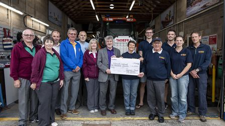 Members of Sidmouth Lifeboat receive a cheque from the Jurassic Bowls Club following a successful to