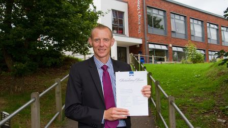 Kings School Headteacher Rob Gammon with the Parliamentary Review. sho 37 18TI 1299. Picture: Terry