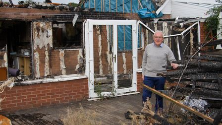 Mike Kendall at his burnt out property in Newton Poppleford. Ref shs 38 18TI 1613. Picture: Terry If