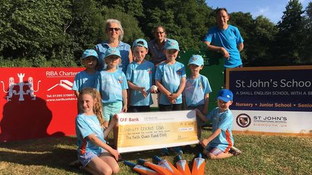 Members of Sidbury Cricket Club receive a cheque from the Sid Vale Association to purchase a new pit