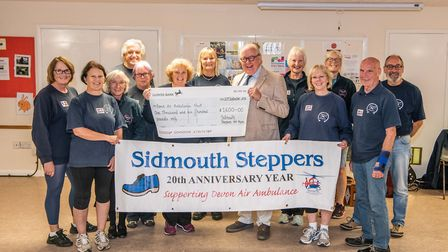Sidmouth Steppers present a cheque of 1,600 to Simon Card from Devon Air Ambulance. Picture: Kyle Ba