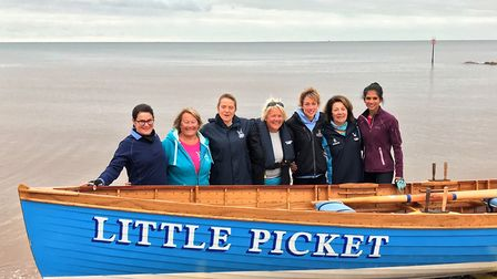 SidmouthGig Club ladies beside their boat before the 11-mile row.