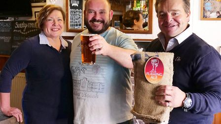 Volunteer Inn landlords Jacqui and Mike Down with Otter Brewery's Patrick McCaig have revealed how t