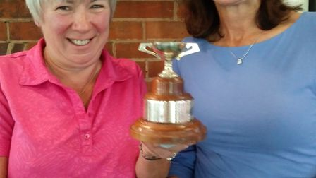 Sheila Faulkner ( left ) with Andrea Milton and the trophy that is presented to the winners of the a