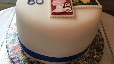 The beautifully decorated cake made by Jill Cavell for the stamp club's anniversary celebration. Pic