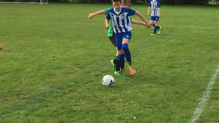 Jake Blackmore in action for Ottery St Mary U13s during the 6-2 cup success over Sidmouth. Picture C