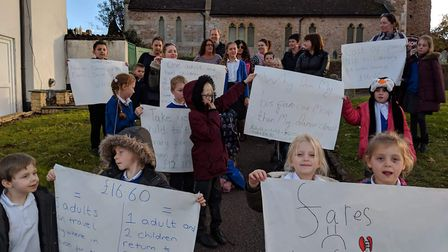 Parents and children gathered in Newton Poppleford to protest over high bus pricez. Picture; Sam Coo