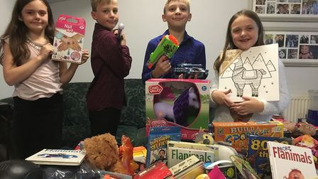 Santa's little helpers, Elloise, Oliver, Jack and Lucia Trebble-Sergent have worked hard to collect
