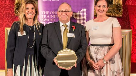 Maxine Carter, Steven James and Nicky French with their award. Picture: Contributed