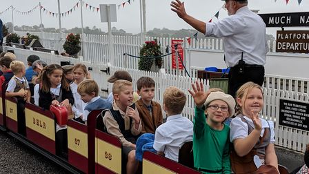 Children of Beer Primary School wave as their train departs. Picture: Sam Cooper