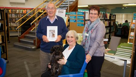 Jenny Fensom and her brother Anthony and dog Midge with Carol Pentacost of Sidmouth Library. Ref shs