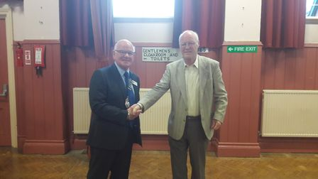 Mayor Glyn Dobson shakes hands with Keith Spittlehouse of the Otter Valley Rotary Club as the announ