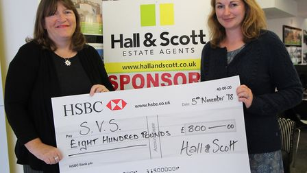 Julia Turner and Claire McHugh of Hall & Scott holding the cheque they donated. Picture: Contributed
