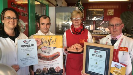 Samantha and Simon Skinner with Kevin and Mary Tratt with their award winning sausages. Picture: Cla
