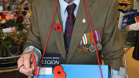 Poppy Appeal collector, Kim Smith, aged 94, colecting at Sidmouth, Waitrose. Picture by Alex Walton.