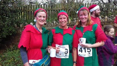 Sidmouth Running Club trio Jo Earlam, Helen Palmer and Jane Hemsworth after the Reindeer Run.