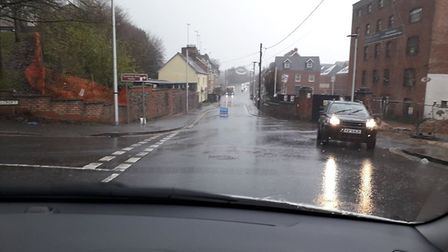 The road is closed outside the Otter Holts development in Ottery following heavy rain. Picture: Ian