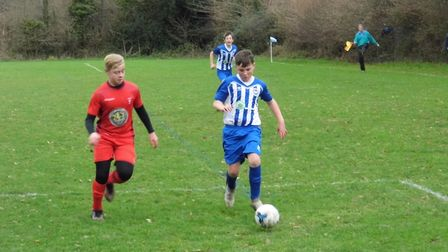 Freddie Clarke in action for Ottery St Mary Under-13s. Picture STEPHEN UPSHER
