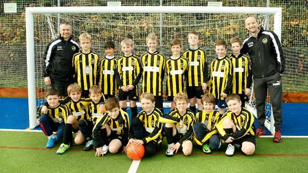 The West Hill Wasps Under-11s team with their coaches. Picture TARA GREIFENBERG