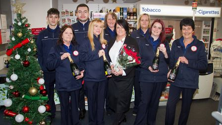 Sam Jones and her staff in the newly refurbished Tesco in Sidmouth. Ref shs 49 18TI 6520. Picture: T