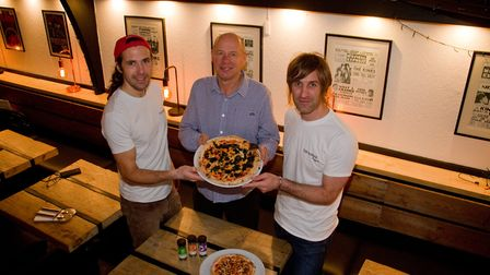 Rob Papworth,Tony Coulson and Phil Borrett with a seaweed pizza. Ref shs 49 18TI 6309. Picture: Terr