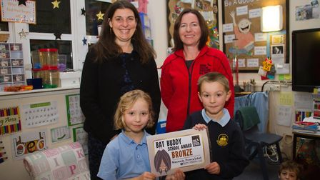 Helen Parr from the Devon Greater Horseshoe Bat Project presents a certificate to Grace,Dominic and