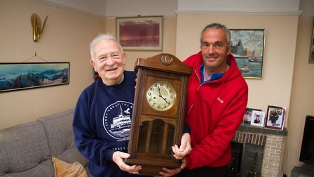 Rick Hastie returns the repaired clock to Don Ryan. Ref sho 44 18TI 4176. Picture: Terry Ife