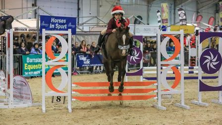 Young riders compete in the show jumping challange. Picture: Wendy Searle