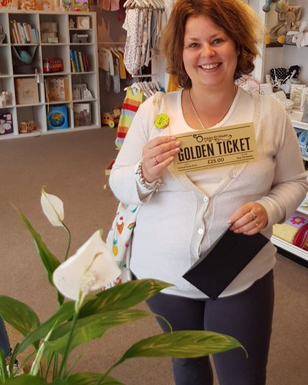 Happy shopper Claire Gaston, showing her £25 Golden Ticket. Picture: Abbie Cook