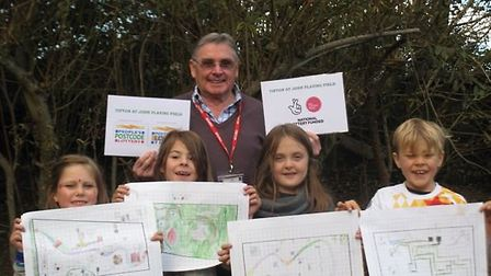 David Boyle with year two children from Tipton Primary School proudly showing their design ideas for