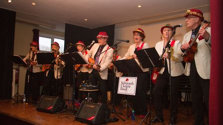 The Sidmouth Ukulele Band at the Sidmouth Lions annual senior citizens Christmas Lunch. Ref shs 49 1
