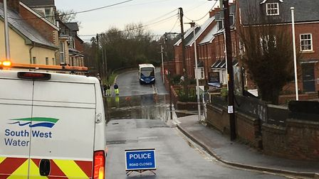 The road is closed outside the Otter Holts development in Ottery following heavy rain. Picture: Cont